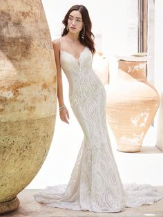 Sottero and Midgley - DAXTON, Lace is ace. (You've imagined it can do many things.) Simple is pretty. Vintage is romantic. And occasionally, it's a vision in form and sophistication. We're especially smitten with how it lines the illusion halter back in this divine lace mermaid wedding gown.
