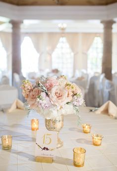 pastel floral centerpieces, tiny gold candle holders, effortless chic // Miranda Laine Photography