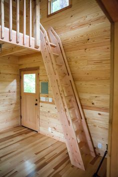 A classic Nelson Treehouse ships ladder takes guests to the loft.