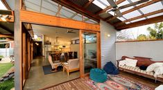 Solar passive extension and renovation, rammed earth, cottage character