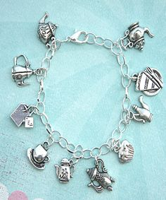 this charm bracelet features tea party inspired tibetan silver charms (nickel free). the charms are attached to a silver tone inches chain bracelet Silver Charm Bracelet, Silver Hoop Earrings, Silver Charms, Bracelet Set, Sterling Silver Bracelets, Silver Jewelry, Charm Bracelets, Jewlery, Ladies Bracelet