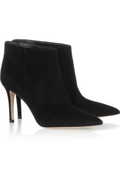 Gianvito Rossi's timeless black ankle boots have been crafted from soft suede and finished by hand. We love how the wide cuffs have a slimming effect on the ankle. Wear this pointed pair with skinny pants. Heel measures approximately 85mm/ 3.5 inches Pull onSmall to size. See Size & Fit tab. ($940)