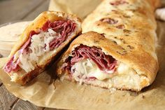 Yall just loved the last stromboli I posted so I decided to give it a little St. This Reuben Stromboli is just as easy as the last one but with all the greatread - Comfort Food Recipes Beef Recipes, Cooking Recipes, Recipies, Italian Recipes, Cooking Cake, Easy Recipes, Stromboli Recipe, Calzone, Reuben Sandwich