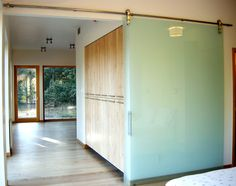 Interior Barn Door With Glass double wall slide doors complement a #rustic #decor. shown here in