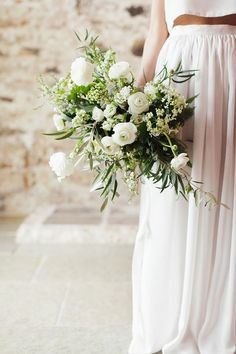 Wild and Organic Spring Wedding Bouquet with Ranunculus and Olive   Rachel Rose Photography on @B.LOVED via @Aisle Society