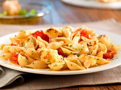 Easy. Delicious. Vegetarian. Barilla® Whole Grain Medium Shells with Roasted Cauliflower & Cherry Tomatoes makes the perfect plate for summer. Get the recipe and enter for your chance to win a $3,000 Al Fresco Dining Makeover!
