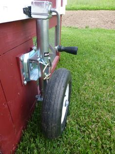 Wheel barrow tire attached to trailer jack. Idea for movable livestock housing