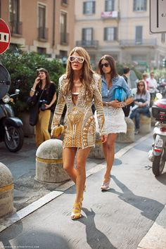 anna dello russo  love Anna!!,   . I find  the woman walking behind her really beautiful