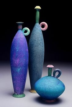 Michael Sherrill I love the asymmetry and the neck and lips on these pots.