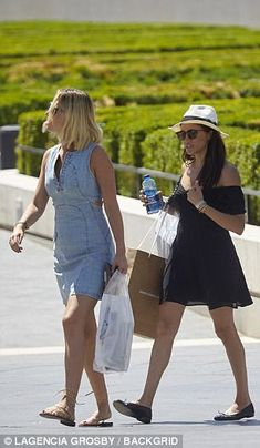 Meghan was seen wearing a black off-the-shoulder sundress, paired with black flats, and a white trilby sunhat