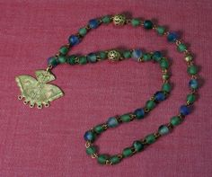 Green, blue green & brass beads with brass pendant necklace