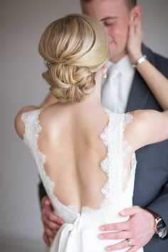 The back of this scalloped lace dress is perfection!! Love this bridal updo with the classy hair pin once her veil came off!!!