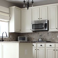When I had originally shared my tutorial From Hate To Great: A Tale of Painting Oak Cabinets, I had absolutely no idea how many people were looking for a tried and true way to transform their outda… Painting Oak Cabinets White, Painting Kitchen Cabinets, Art Cabinet, Oak Cupboard, Oak Bathroom, Bathroom Ideas, Oak Kitchen Cabinets, Kitchen Reno, Kitchen Paint Colors