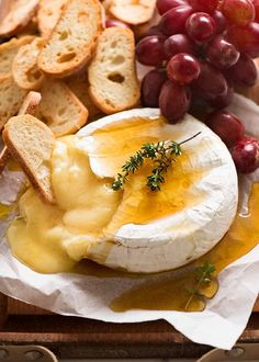Baked Brie served with crisp breads and grapes It's the world's easiest appetiser / party starter! Just pop a brie in the oven for 15 minutes, or microwave it for 2 minutes. Plonk on a platter, add a mound of crispy crackers and watch the hands dive in. Appetizers For Party, Appetizer Recipes, Appetizer Ideas, Party Snacks, Brie Au Four, Fondue, Fromage Cheese, Camembert Cheese, Crisp Bread