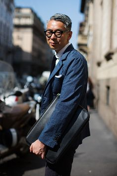 """""""Small-scale printed cotton sportcoat…… Check!     Black framed old-school glasses….. Check!     Black leather portfolio….. Check!     White shirt & dark tie…. Check!     I think we have a new trend!"""""""