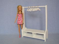 http://www.ebay.com/itm/Clothes-Rack-1-6-scale-Barbie-size-Dollhouse-Furniture-Wood-Clothing-Rack-/291901790639?hash=item43f6b3d9af:g:MIUAAOSwmLlX9rbZ
