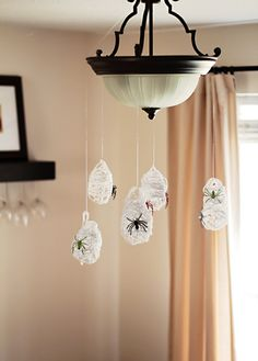 Spiders eggs...  Elmers, tiny bit of water & white yarn   wrap around sm. baloon -dry.  Pop/ remove baloon & hang w/tiny spider.