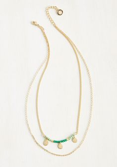 How Dew That Is Necklace. Each admiring glance and word of praise reveals a truth about this golden necklace from Lovers Tempo - that its morning mint and sweet teal crystals are absolutely elegant!  #modcloth