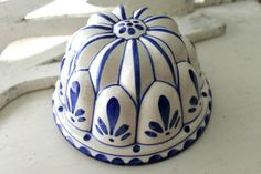lovely white and cobalt blue round ceramic mold handpainted  no makers mark---most probably from the 1980s hole at the top is fitted with wire