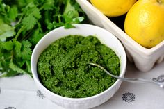 Healthy Lemon, Herb & Kale Pesto      This pesto brings together so many healthful ingredients in a delicious     way!  Kale, basil, cilantro, parsley, lemon, garlic, and olive oil are     all super foods that will brighten up a meal while loving your body.      Toss this with some pasta or