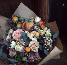 My favorite colors in a bouquet. Borrowed from a painting. Leaves that look blue, teal even. Petals that look like clementine peels, faded pinks, stray twigs. My Flower, Fresh Flowers, Beautiful Flowers, Fall Flowers, Flower Bouqet, White Flowers, Beautiful Things, Beautiful Bouquets, Bunch Of Flowers