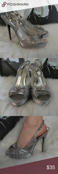Satin and Mesh Glitter Heels Beautiful Satin and Mesh glittered heels. Perfect for a formal event or a night out. Adjustable strap. Gently used small minor scuffing as pictured. Offers welcome! Touch of Nina Shoes Heels