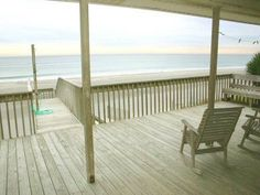 Surf Husker is a beautiful 4 bedroom, 3 bath cottage right on the water. Enjoy the wrap around porch with your small pets!