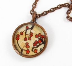 Tiny watercolor painting crafted into a necklace...love it.
