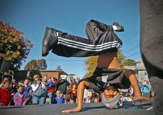 Kobi George, 9, performs a hip-hop dance move at the 17th annual Quincy Harvest Festival on Saturday, Oct. 13, 2012. Amelia Kunhardt/The Patriot Ledger, Purchase this photo, $8