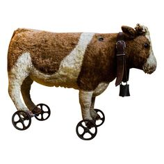 antique Steiff toy cow on wheels