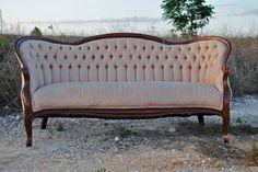 Antique Pink Settee..I love the dark wood frame.