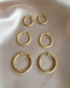 Gold hoops earrings perfect for layering with multiple earholes. Petite size to medium size hoops.