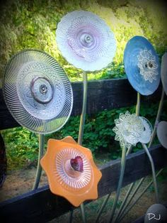 Glass garden flowers - Saw these at a farmers market. Loved them. Spittin-Toad blog had directions to make.  Might try this.