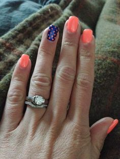 Vacation Summer Nails - Florescent orange/pink nails with a blue accent nail