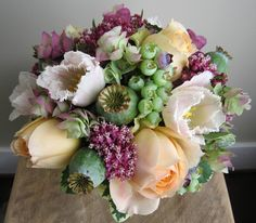 Here's the photo that started it all, from the floral designer that really truly sparked my passion for floral design about 5 years ago, Seattle's Ink & Peat.  At first I thought the pretty layered and variegated purple and green stuff snuck in there was some kind of cool antique-y hydrangea,…