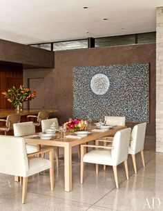 n the dining area, a 1962 painting by Richard Pousette-Dart overlooks a custom-made cerused-oak table and armchairs, the latter upholstered in a J. Robert Scott leather.