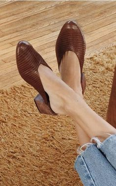 embossed leather mule heels from Mari Giudicelli and raw hem jeans.