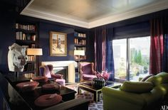 Interior decorator Thomas Britt created a new study/screening room for a penthouse apartment in New York's Greenwich Village. He designed the sofa and bought the dhurrie in India; the Italian sculpture is from Amy Perlin Antiques.