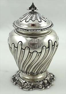 Frank smith sterling tea caddy - An antique sterling silver tea caddy by Frank Smith with gadrooning on the body and lid and chased border around the base. Art Deco monogram on one side.