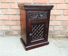 The Lattice #Nightstand is intricately hand carved from solid rosewood, with a wooden woven Jali door, and a drawer. The lattice door is carved to match the wooden grill work on our Indian Beds. #NightstandDecoration #DecorativeNightStands