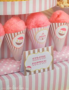 Pink candy floss. Get cones and then order stickers with the logo and the event name and stick on each. Could also have bigger clear bags instead with the sticker on.