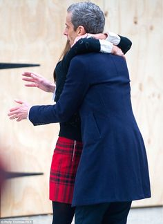 Arms everywhere: The Doctor doesn't know what to do with himself as Clara leans in for a comforting hug