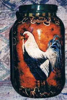 A gallon size glass pickle jar I painted a rooster on.