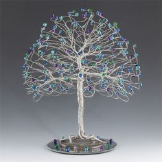 I love light blue and brown together! Make your wedding or other event special with this tree cake topper with aquamarine and smoked topaz swarovski crystal elements. Each tree is handcrafted to...