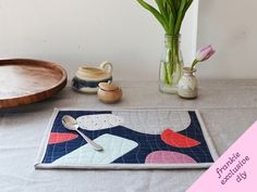 I firmly believe that quilting isn't just for quilts. And if you don't believe me, have a go at making these super-cute quilted placemats...