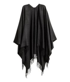Black. Poncho in woven fabric with fringe at hem. Width 53 1/4 in., length of back 30 3/4 in.