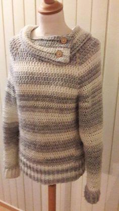 Henny Dries mailde mij dit weekend de foto's van haar eigen gehaakte trui naar het patroon van juf Sas. Ze heeft de trui een kraag gegeven. Dit heeft ze zo ged