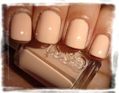 """Essie - """"A Crewed Interest""""  this is as orange as I'll get on my nails."""