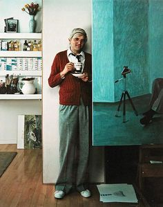 Arnold Newman/  David Hockney, with cup and saucer in hand, in his studio in 1978