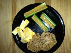 Seed crackers with cheese and celery with natural peanut butter